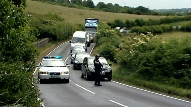 Mother of Raoul Moat victim interview July 2010 Rothbury EXT Police roadblock and police marksmen along in field Army jet flying overhead