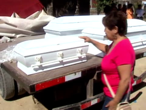 Mother opens coffins to identify bodies of earthquake victims following devastating earthquake Chile 2 March 2010