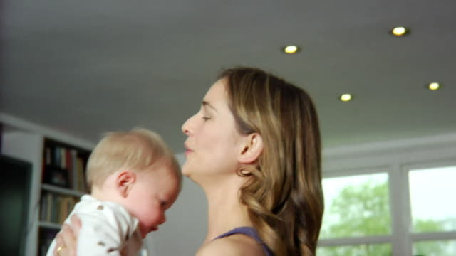 SLO MO CU Mother playing with baby boy (6-11 months) / London, United Kingdom
