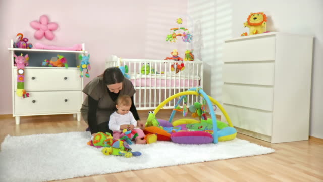 HD DOLLY: Mother Playing With Her Baby