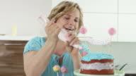 mother prepares birthday cake for child's birthday