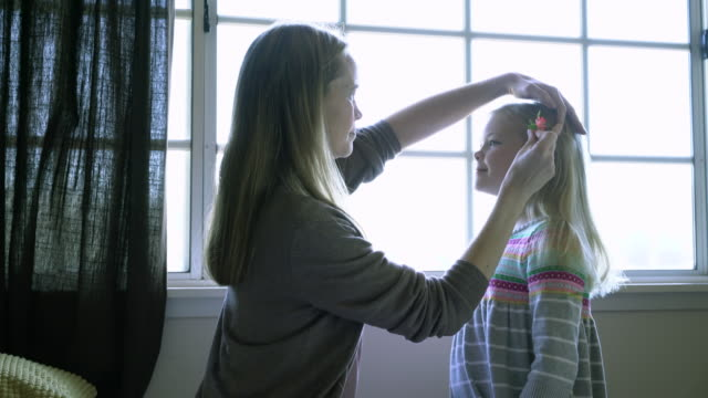 MS Mother putting a flower in her daughter's hair