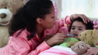 MS PAN Mother Taking Temperature of Sick Child in Bed / Richmond, Virginia, United States