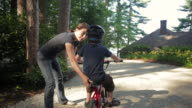 MS Mother teaching her son to ride bike / WOLFEBRO, NH, USA