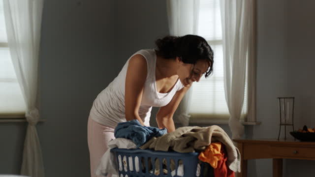 mother with baby in laundry basket