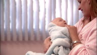 SLO MO, CU, TU, Mother with newborn baby in hospital room