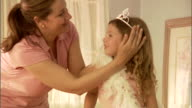 CU, Mother wrapping daughter (4-5) with feather boa