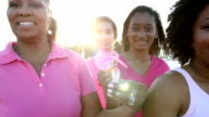 Mothers, daughters with breast cancer awareness ribbons