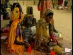 Mothers feeding young children in refugee camp Darfur Jun 04