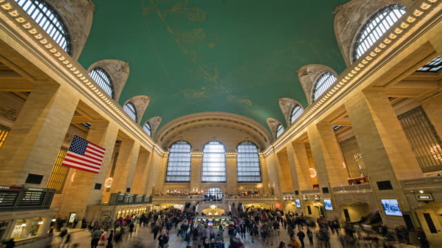 Motion Control time-lapse of Grand Central Station in New York City great hall with commuters.