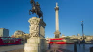 Motion controlled time lapse footage of morning rush hour traffic going around Trafalgar Square in London.