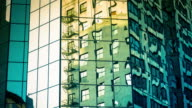 Motion Timelapse of Abstract Reflections in Modern Office Building