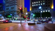 Motion Timelapse of Busy Intersection in Downtown Los Angeles Financial District at Night