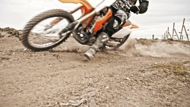 SLO MO Motocross biker speeding through the turn