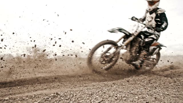 SLO MO Motocross riders riding through the turn
