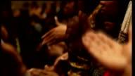 US motor industry financial crisis / Motown 50th anniversary EXT Cross General view of Second Ebeneezer Church Churchgoers dancing as choir sings...