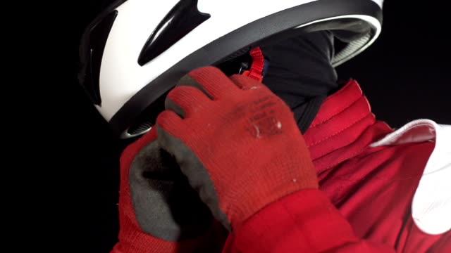 Motor racing / Formula One Driver fastening helmet strap