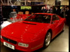 Motor Show CF ENGLAND London Earls Court MS New Rolls Royce on display TMS Porsche car as turning on turntable MS Flame Red Ferrari car on display MS...