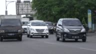 Motor vehicles drive in the center of Banda Aceh Indonesia