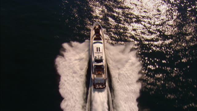 LOW AERIAL, Motor yacht crossing ocean, near Newport, Rhode Island, USA