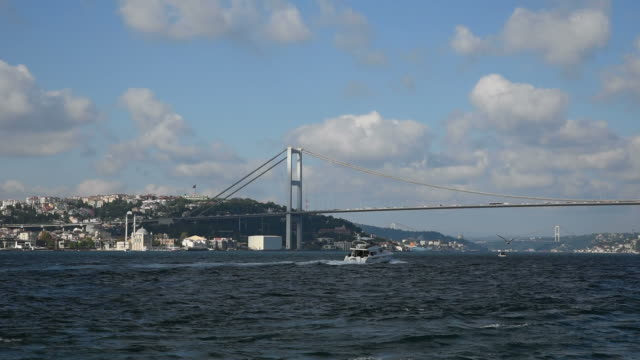 Motor Yacht Passing Under The Bosphorus Bridge