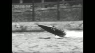 Motorboats racing on the River Seine in the Six Hours of Paris boat race / boats jump up and down on water's surface / checkered flag lowered after...