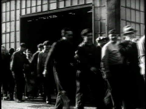 1940 WS Motorcar company workers walking by / United States