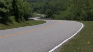 motorcycle drives winding road