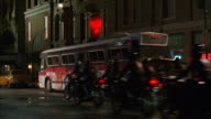 MS Motorcycle rider gang tossing bomb in older city bus, bus exploding and burning