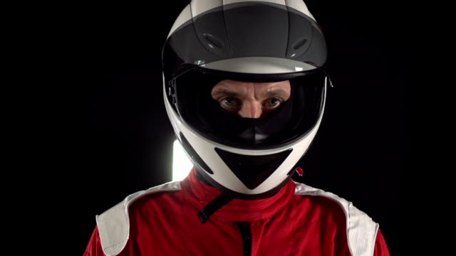 Motorcyclist / Formula One Driver looking up - Slow motion
