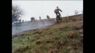 MONTAGE Motorcyclists riding uphill during practice drill / United Kingdom