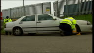 Clampers threatening strike action over incentive scheme ITN Wheel clamp being affixed to car