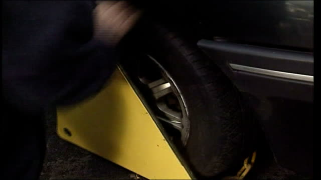 Government proposals for changes to parking charges FILE / TX London Car wheel being clamped Penalty notice on car windscreen TILT DOWN to clamp on...