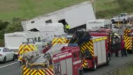 3 people still in critical condition after crash that killed 4 1692017 Emergency service vehicles at scene of crash Accident scene with screens...