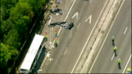 two people dead ENGLAND Essex M11 Motorway near Stansted VIEW / AERIAL wreckage of coach on motorway with tow truck and police vehicles at scene