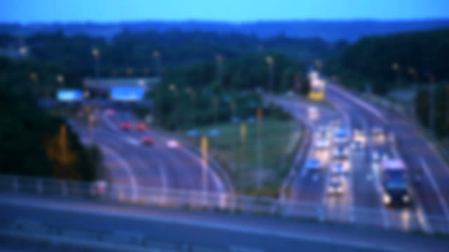 UK Motorway, M25/M26/A21 traffic at dusk.