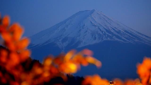 Mount Fuji and snow on peak at night at Kawaguchiko