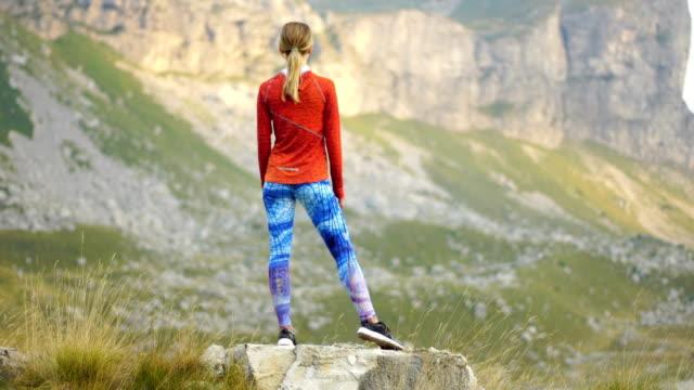 Mountain adventure. Young woman training
