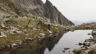 Mountain biker finds route along alpine lakeshore