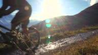 Mountain biker rides along high mountain trail