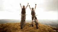 TS SLO MO Mountain bikers reaching the top
