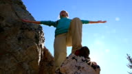 Mountain climber arms outstretched