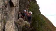 MS PAN Mountain climber jumping over camera / Provo, Utah, USA