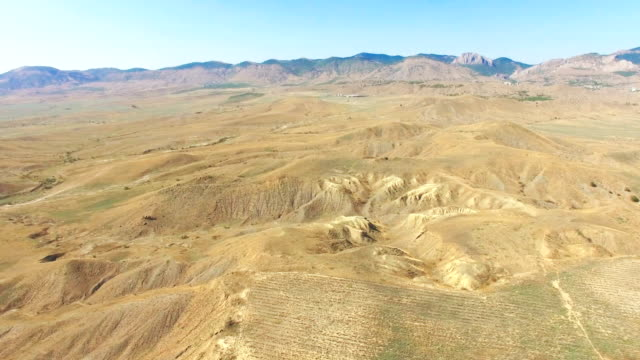 AERIAL: Mountain plateau on background of blue sky