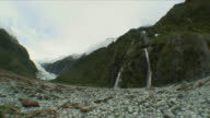 WS Mountain range with glacier and waterfall / Franz Josef Glacier, New Zealand