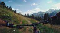POV mountainbiking action: enduro riding on the Alps