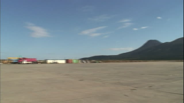 Mountains are visible from the Mendeleyevo Airport construction site.