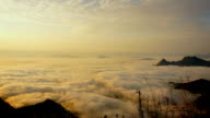 (Time Laspe) mountains landscape with Moving Mist over forest on the sunrise .