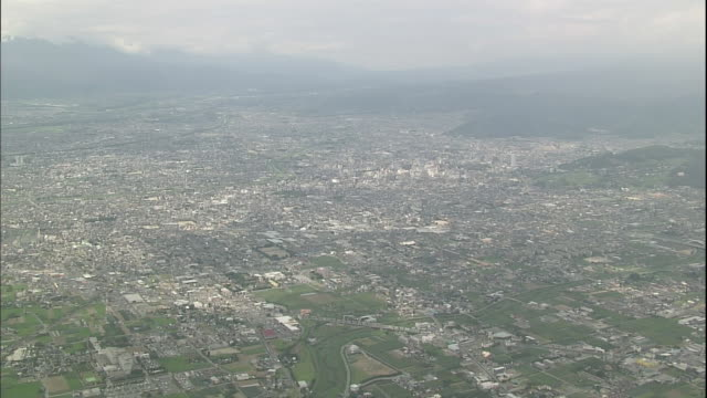 Mountains surround the city area of Kofu in Yamanashi, Japan.