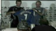 Mourinho posing with Chelsea signing Andriy Shevchenko WIPE TO